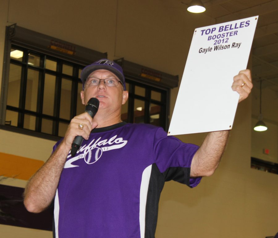 Superintendent+Lacy+Freeman+helps+out+with+the+auctioning+of+parking+passes+for+the+football+games.+The+money+raised+from+the+passes+went+to+each+organization+represented+at+Meet+the+Bison.+