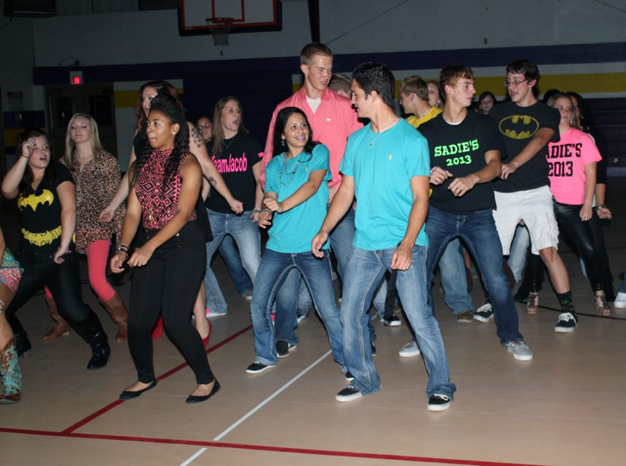 Students enjoy a group dance at the Sadie Hawkins homecoming dance on Saturday night.