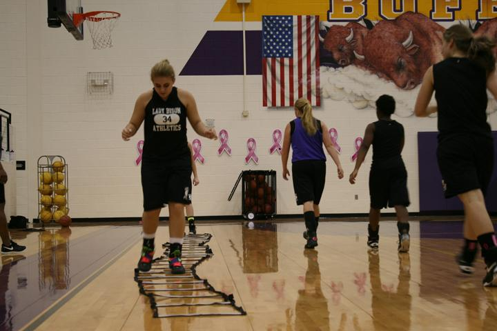 Senior Jessica Presutti works on her agility during after school practice. Even though the volleyball team is moving into the playoffs, the basketball girls were starting their season. Players on both teams doubled up on practices.