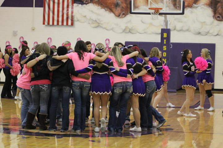 The+Lady+Bison+huddle+up+on+the+court+for+a+good-luck+wish+during+the+Pink+Out+pep+rally+the+Friday+before+their+tie-breaker+game+against+Rice.+The+team+won+the+game+to+clinch+third+place%2C+and+will+start+their+play-off+run+Tuesday+night+at+Madisonville+High+School+with+a+game+against+Anderson-Shiro.