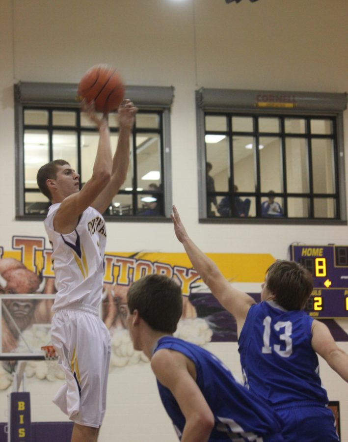 Senior+Tyler+Adams+gets+into+the+air+and+over+the+defense+to+score+two+in+the+Blooming+Grove+basketball+game.+