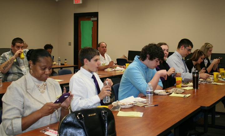 Students from the speech class and the adult members of the mock trial take a quick break for lunch before continuing to work on the evidence and debates surrounding the mock trial that an Arkansas lawyer argued in front of them Tuesday. The trial he was practicing on is a civil matter that will be tried in Leon County later this year.
