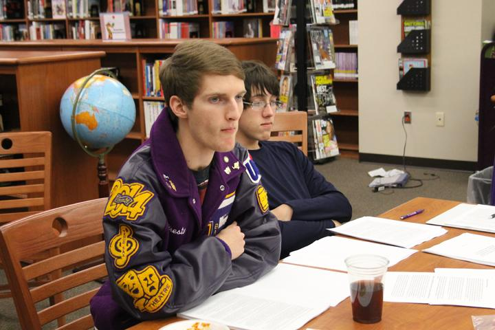 Seniors Preston Mosley and Ryan Slatter listen to the debate teacher who came to work with the group and their coaches. CX debate competes at district on Jan. 30.