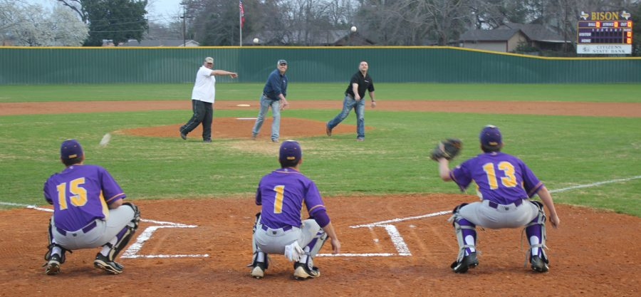 Community members throw out the first pitch before starting the games at the new baseball and softball complex. Pitchers are, from left to right, are Monty McGill, Kent St. Pe, and Dominic Benoit. Catchers are Clay McGill, Logan Jones, and Trey Minter.