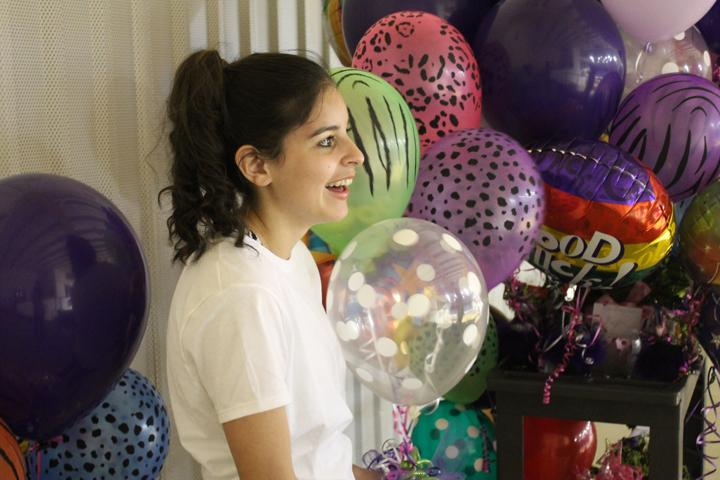 Sophomore Kendall Morales waits her turn to try out for cheerleader amid balloons and flowers delivered to the girls to wish them good luck.