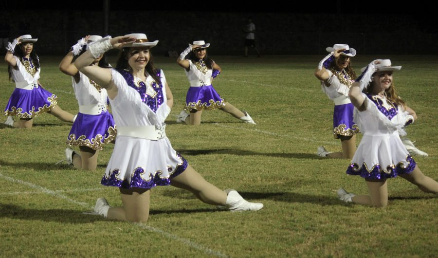 The Bison Belles show off their moves during a halftime show.