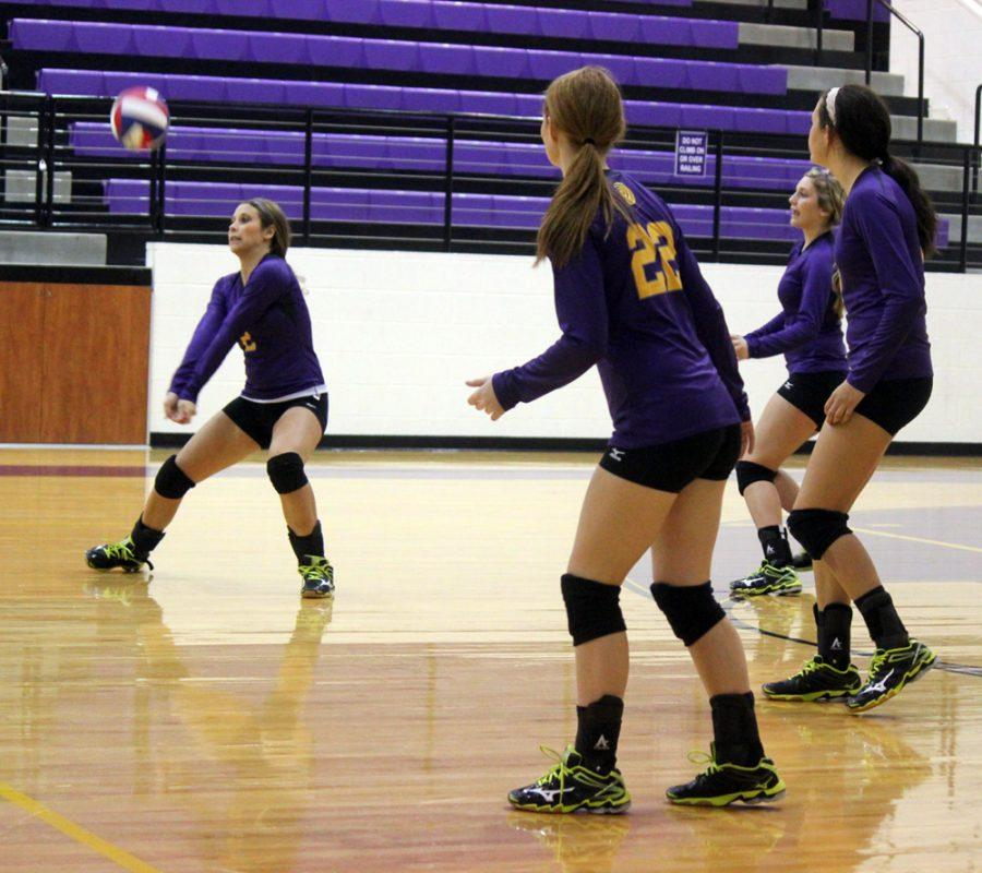 Senior Marissa Jones gets ready to bump the ball during the Lady Bison game against Hearne. The Ladies won in 5 matches.