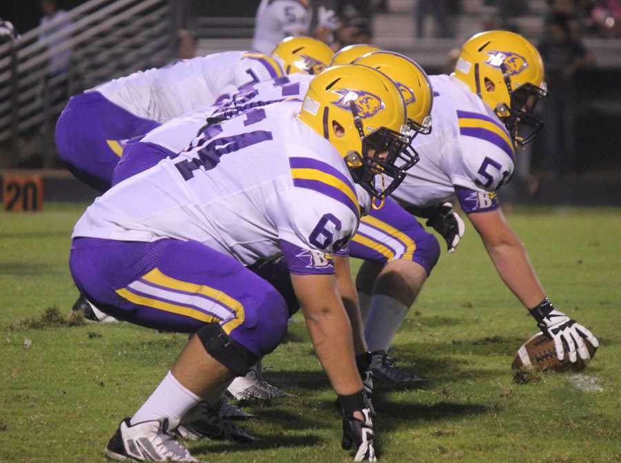 The+offensive+line+gets+set+to+gain+some+yardage+during+the+game+against+Alto.+The+varsity+lost+0-65.+