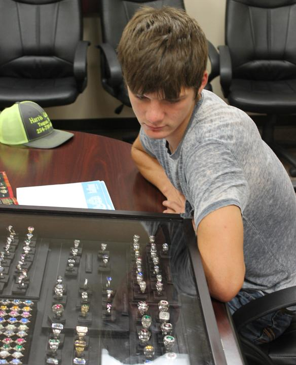 Junior Lane Solley looks over the ring choices before placing his order with Balfour.