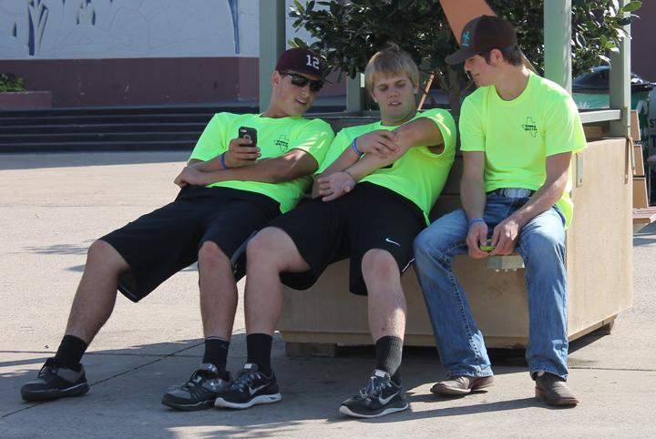 Clay McGill, Jordan Bryson and Lane Solley take a break while spending the day at the state fair. The FFA and FCCLA members delivered canned goods for the food drive and took part in other fair activities for the groups.