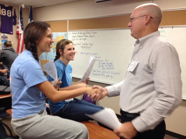 Superintendent Lacy Freeman shakes hands with junior Allison Grissett during the history class simulation. Freeman joined the class for the first day of the activity.