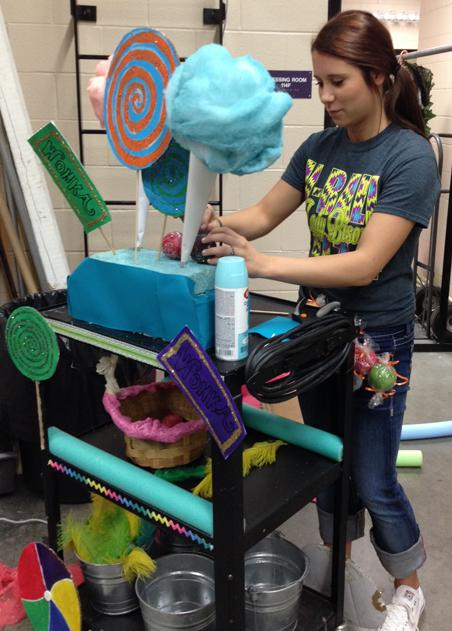 Senior Marissa Jones works on a prop for Willy Wonka and the Chocolate Factory.