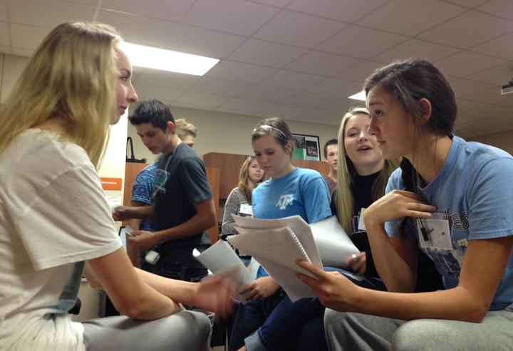 Juniors in history class try to sway votes during a senate simulation.