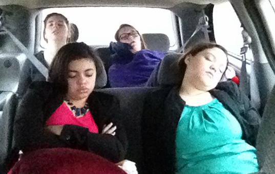 Debaters riding with coach Jill Henson try to catch up on their sleep on the early-morning drive from Buffalo to Belton for a speech meet.