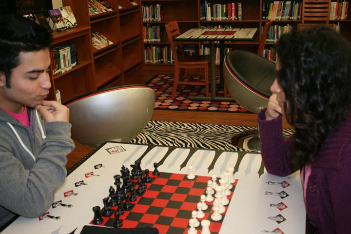 Senior+Sergio+Vazquez+and+junior+Miryam+Zapata+spend+their+activity+period+engrossed+in+a+chess+game.+