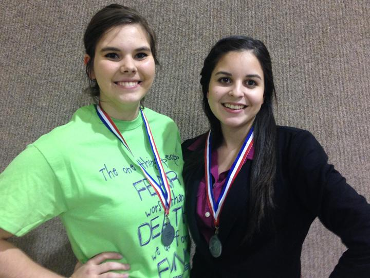 Juniors Kaci Allen and Kendall Morales show off their medals after placing second in district CX Debate. They will compete in the state meet in March.