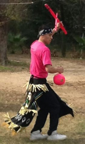 Junior Luis Ortiz participates in a traditional Mexican dance.