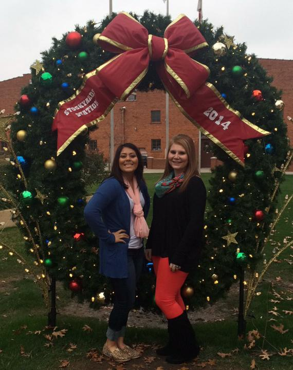 Juniors Brittnie Garcia and Makayla Troyer pose for a Christmas picture while on the Spanish Club trip to Ft. Worth.