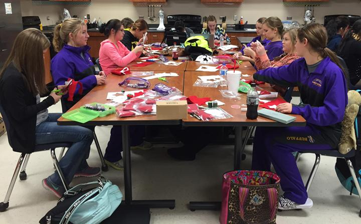 PHS students work on their Christmas ornaments in class using their new sewing skills.