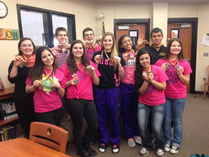 The+members+of+the+speech+and+debate+team+show+off+their+medals+won+at+Saturday%27s+speech+meet.