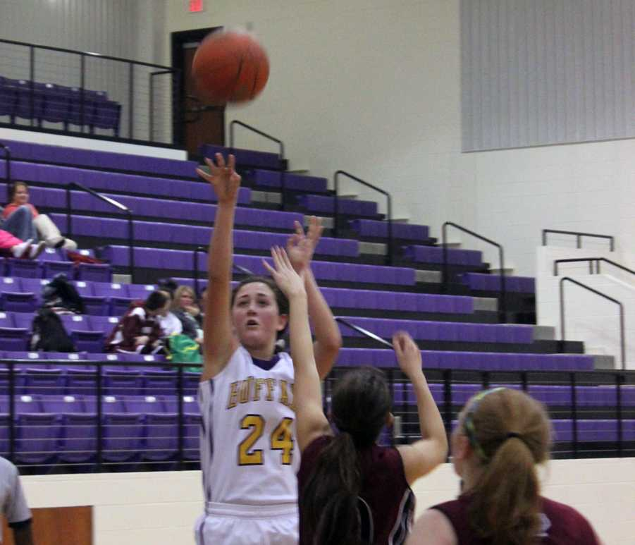 Junior Allison Grissett launches the ball into the air for two points.