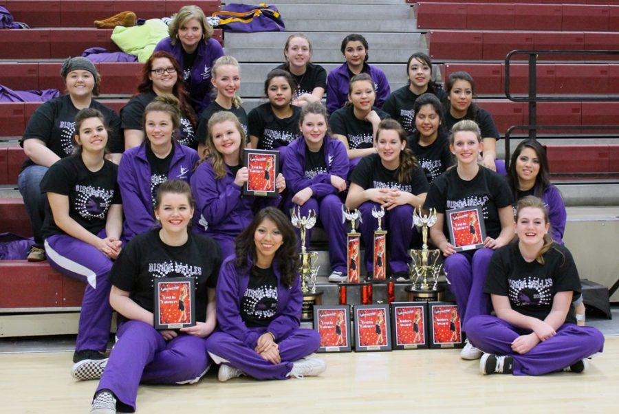 The+Belles+show+off+awards+won+at+their+competition+on+Saturday.+The+girls+were+up+against+several+local+high+schools%2C+all+larger+than+Buffalo.+The+will+compete+in+Galveston+next+month.