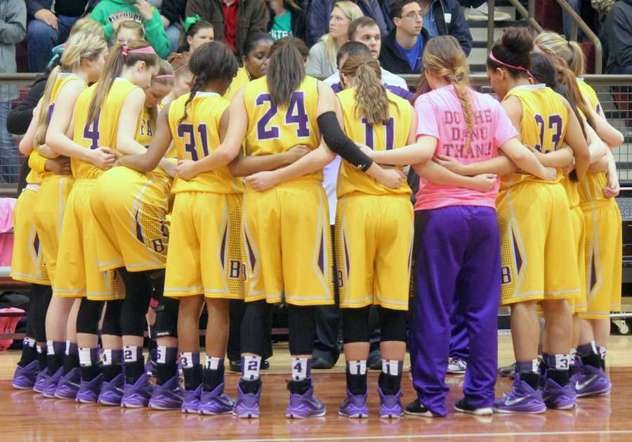 The+Lady+Bison+huddle+with+coach+Jo+Jenkins+before+their+Bi-District+game.+