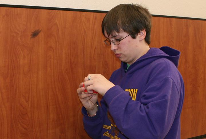 Forensics Club member Austin Melton gets ready to collect evidence during a class project.