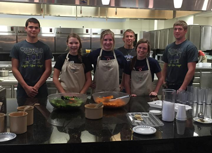 Junior+Logan+Freeman+poses+with+other+students+volunteering+to+cook+meals+at+the+Ronald+McDonald+House+last+week.+