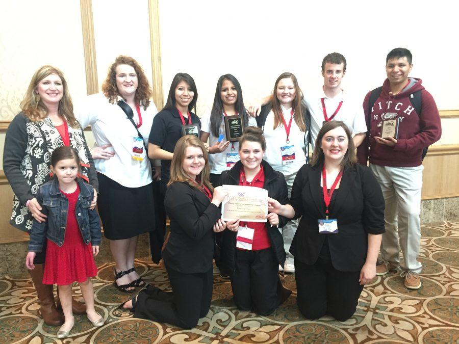 The+FCCLA+competitors+pose+with+their+sponsor%2C+Wendy+Neyland%2C+and+the+awards+they+received+at+regional+competition+in+Galveston.+Three+teams+will+advance+to+state+in+April.