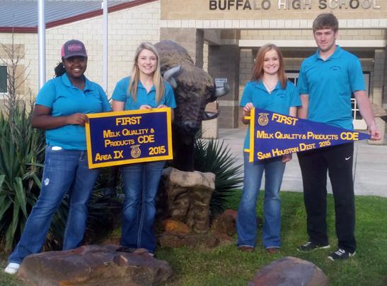 Adrian Randle, Jacie Jones, Taylor Shelton and Logan Freeman show off the banners they won in the milk judging competition. Their team and the Meats Team is advancing to state competition.