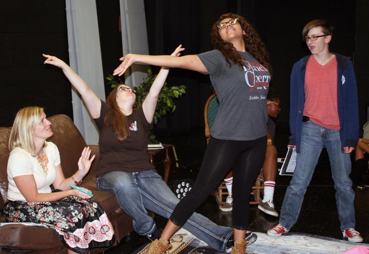 Theatre director Jill Henson works on movement and expression with some of her cast.