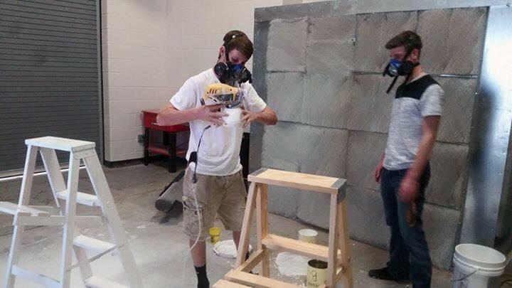 Ag+students+try+out+the+new+painting+booth+to+paint+ladders+for+the+Bison+Belles.