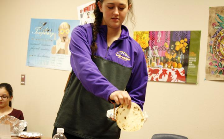 Senior Allison Grissett discusses the tortillas she made for the celebration.