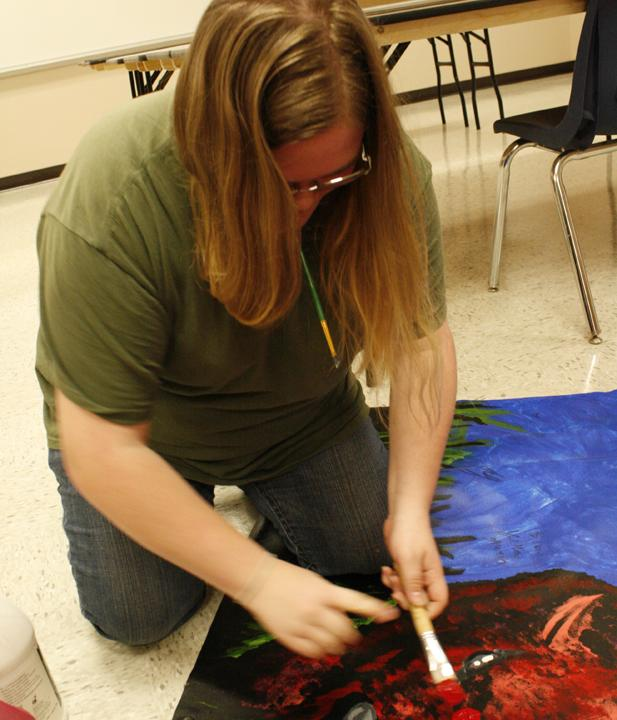 Senior Kortney Cannon works on a painting during art class.