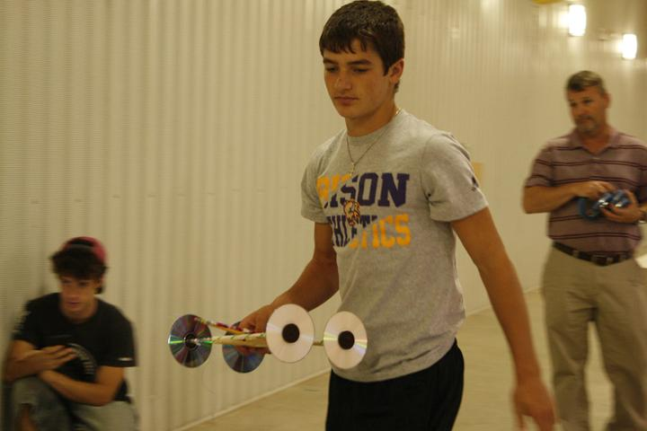 Junior Shelley Pate gets ready to race his mouse trap car.