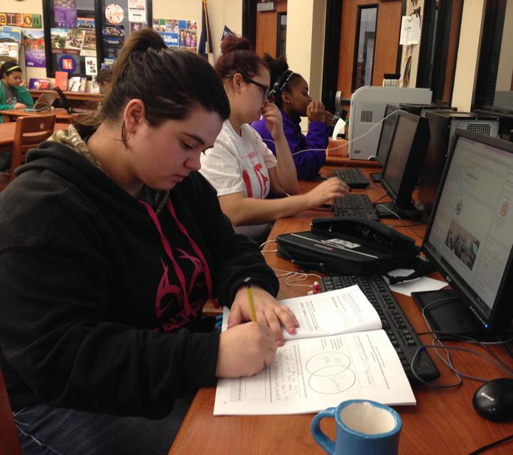 Freshman Kaiden Loep works on an assignment during journalism class. Loep placed in the contest.