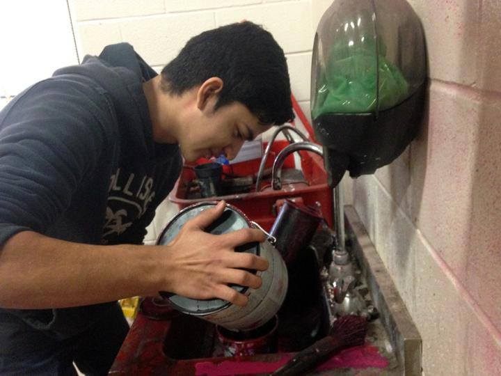 Junior Jesus Cardenas mixes paint while working in the ag shop.