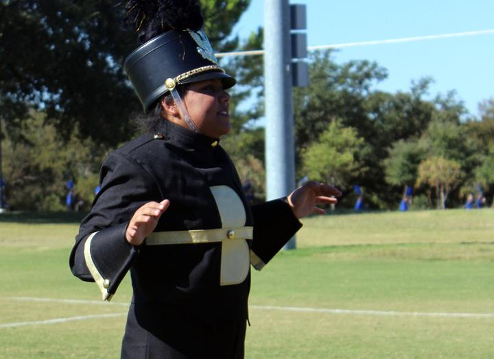 Senior+Diana+Avila+rehearses+the+band+before+competition+in+October.+Avila+is+one+of+two+drum+majors+for+the+Bison+Brigade.