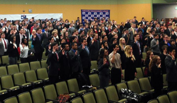 Competitors at state congress take the oath of office before starting their debates.