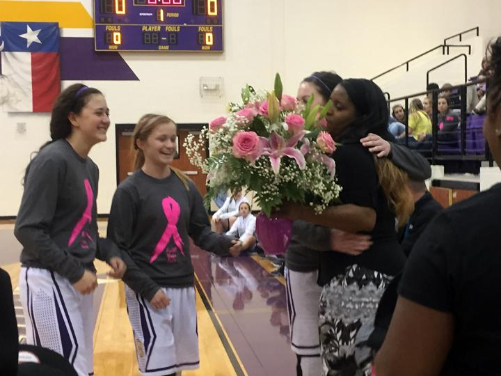 Coach+Jozette+jenkins%2C+who+battled+cancer+during+much+of+last+year%27s+basketball+season%2C+receives+pink+flowers+and+plenty+of+hugs+from+her+team.