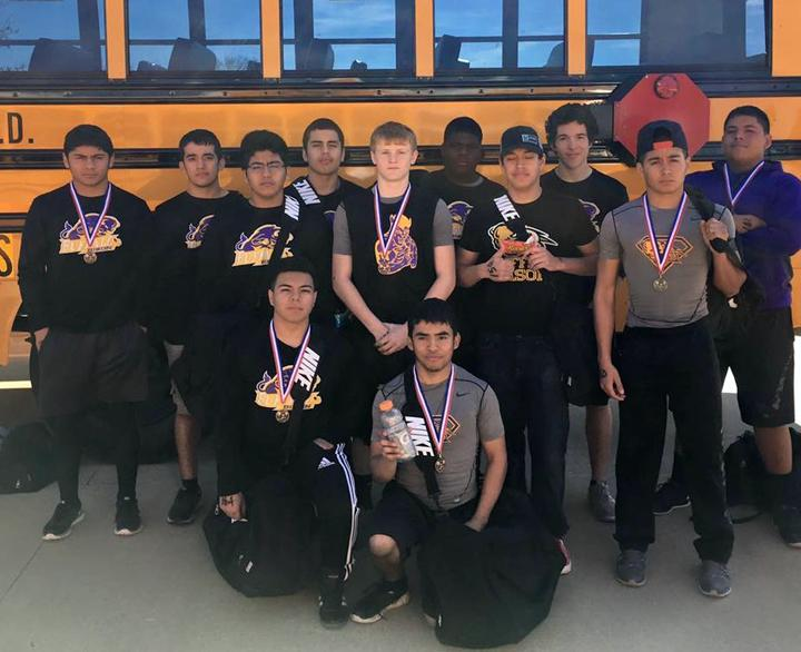 The+power+lifting+team+shows+off+their+medals+after+a+meet+in+Elkhart+Saturday.+