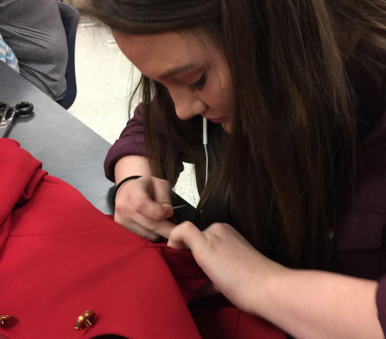 Senior Brianna Johnston works on a clothing project during FCS class.