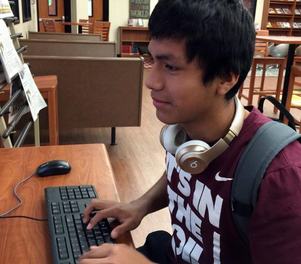 Sophomore Jordy Maltos works on a speech assignment in the library. Jordy is a part of the competitive speech and debate team.