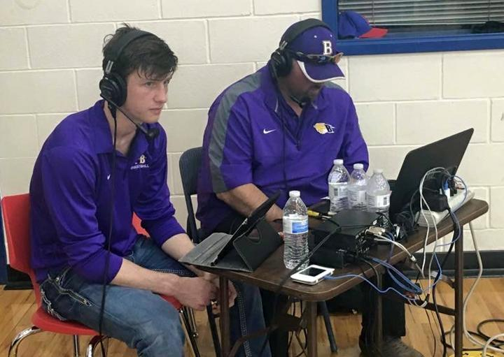 Senior Dylan Harris helps out Monty McGill with a local radio broadcast. Dylan has been playing basketball since kindergarten.