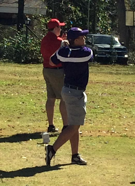 Freshman Noah Rubel watches his shot at a tournament early in the season.