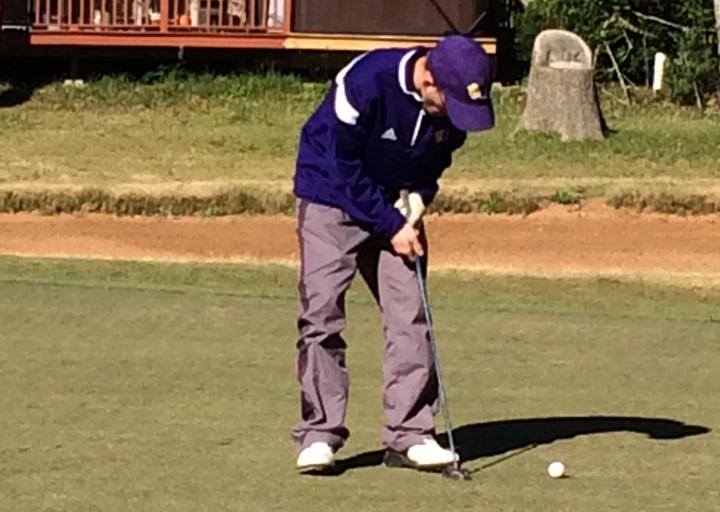 Justin+Foley+focuses+on+his+shot+at+an+early-season+golf+tournament.