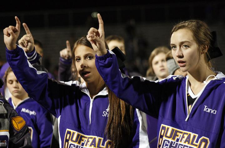 Freshman+Sheri+Donaldson+and+fellow+cheerleader+Tana+Cleveland+sing+the+school+song+at+the+end+of+a+football+game.+