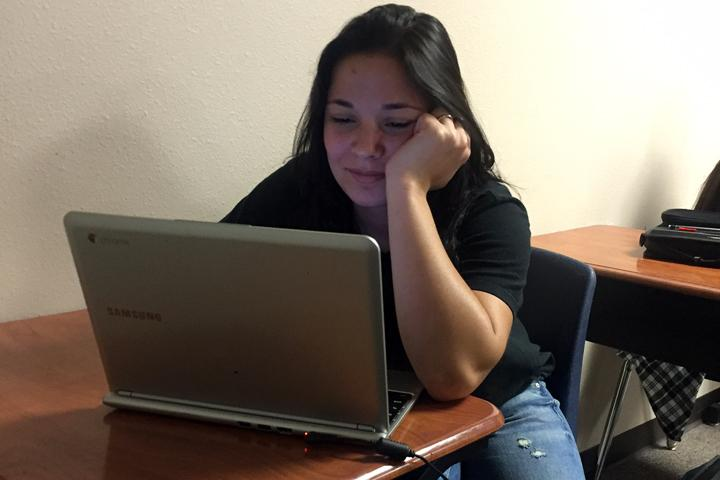 Denise Wall works on a class assignment on her Chromebook.