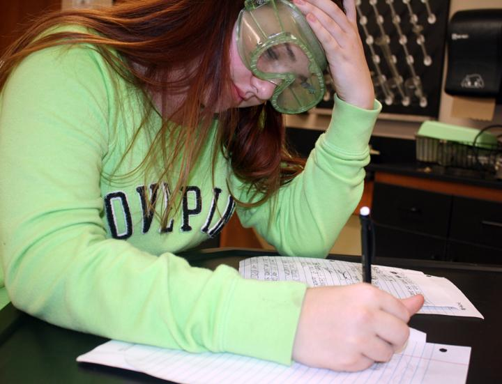 Freshman Destiny Hammons works on an assignment during science class.